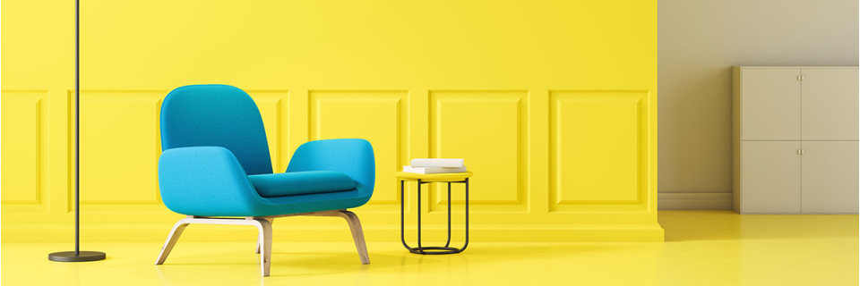 yellow vibrant wall and floor with single blue arm chair