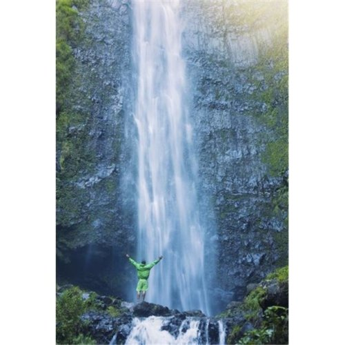 Man Standing At The Base of Large Waterfall in Hawaii Poster Print by Design Pics Vibe, 22 x 32 - Large