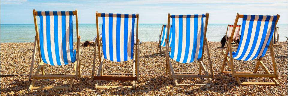 four deck chairs at the beach