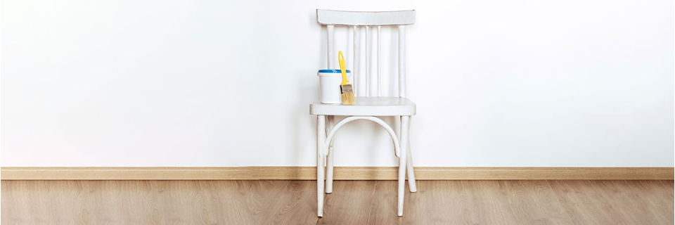 white chair with paint and brush