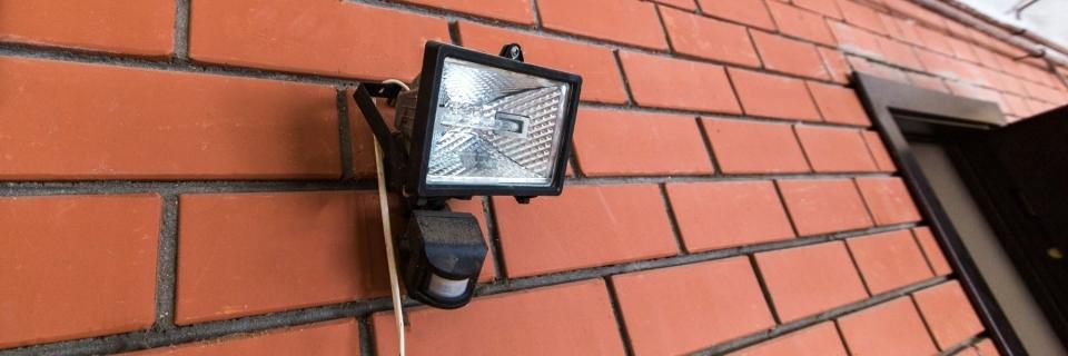 security light on brick wall