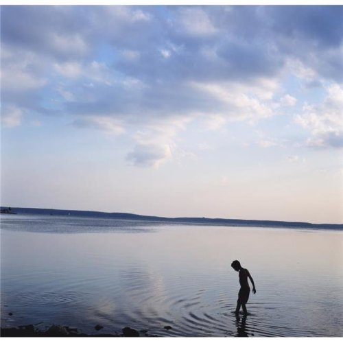 Boy In Silhouette Wading In Ocean Poster Print, 24 x 24 - Large