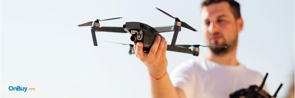man holding drone