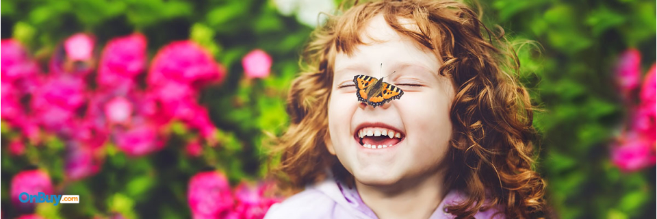 happy little girl with butterfly on her nose