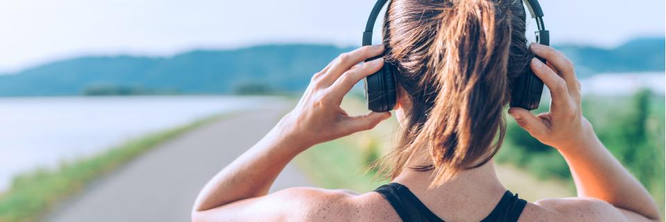 Woman adjusts headphones