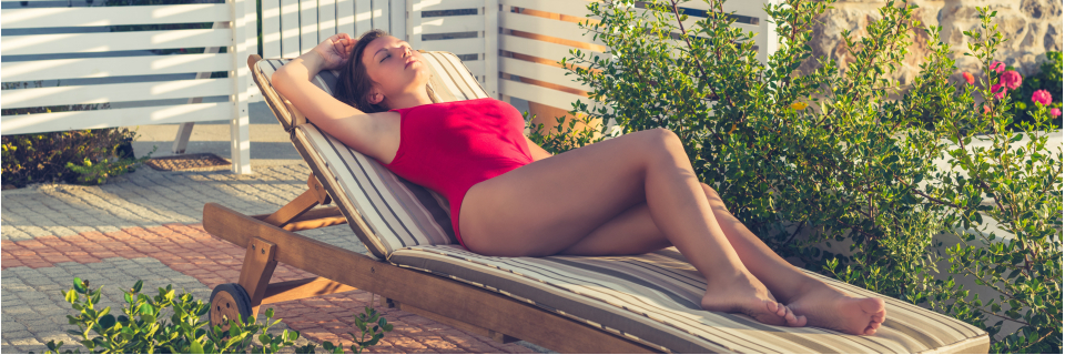 woman in red swimsuit on a sun lounger