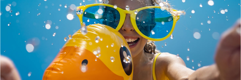 girl playing in water on inflatable
