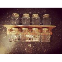 Rustic spice storage shelf with jars by whatnots