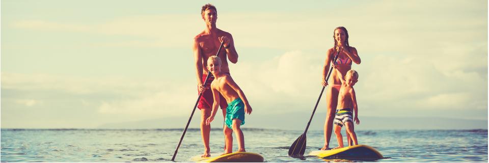 family enjoying paddle boarding