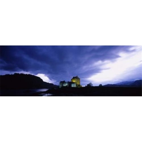 Low Angle View Of A Castle Lit Up At Dusk  Eilean Donan Castle  Highlands  Scotland  United Kingdom Poster Print by  - 36 x 12
